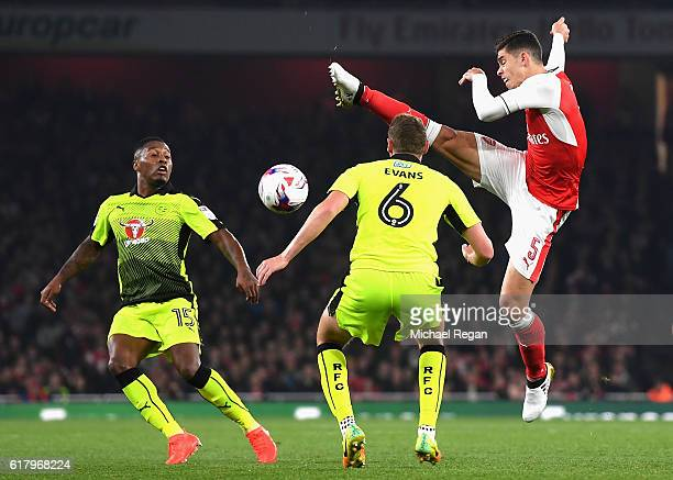 Gabriel of Arsenal attempts to volley the ball while George Evans of Reading and Callum Harriott of Reading look on during the EFL Cup fourth round...