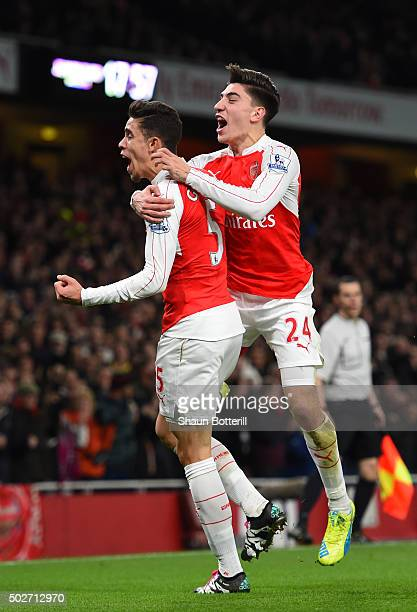 Gabriel of Arsenal celebrates scoring his team's first goal with his team mate Hector Bellerin during the Barclays Premier League match between...