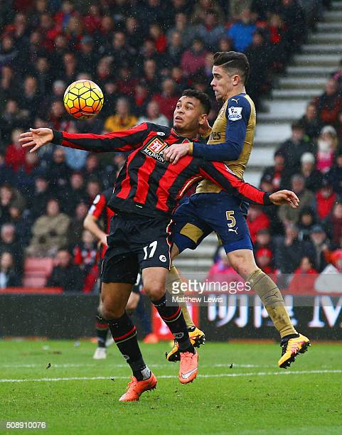 Gabriel of Arsenal jumps with Joshua King of Bournemouth during the Barclays Premier League match between AFC Bournemouth and Arsenal at the Vitality...