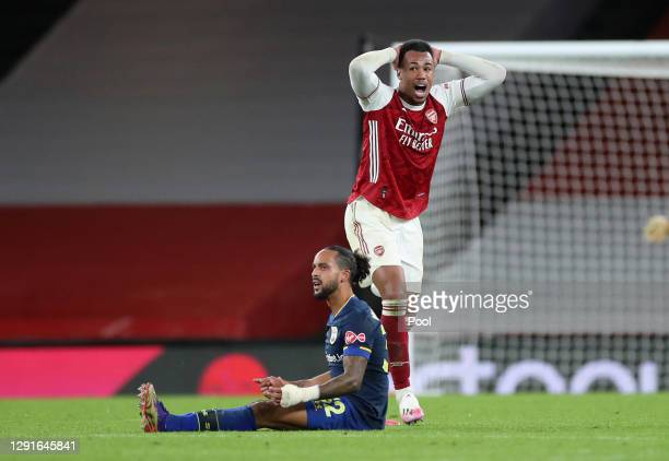 Gabriel of Arsenal reacts after a challenge on Theo Walcott of Southampton which results in Gabriel being sent off for a second yellow card during...