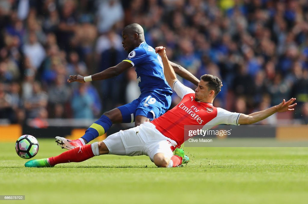 Gabriel of Arsenal tackles Enner Valencia of Everton resulting in Gabriel being stretchered off during the Premier League match between Arsenal and Everton at Emirates Stadium on May 21, 2017 in London, England.