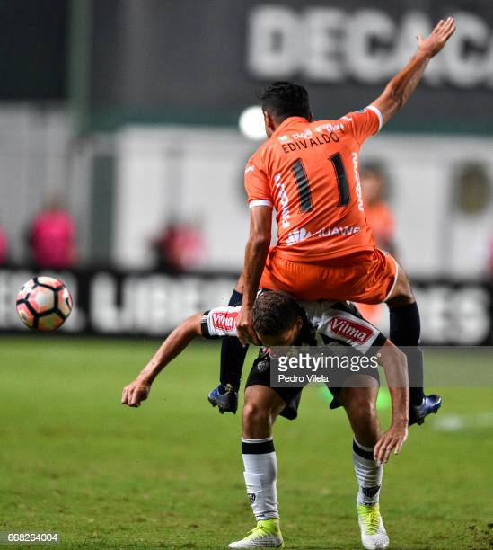 Gabriel of Atletico MG and Edivaldo of Sport Boys battle for the ball during a match between Atletico MG and Sport Boys as part of Copa Bridgestone...