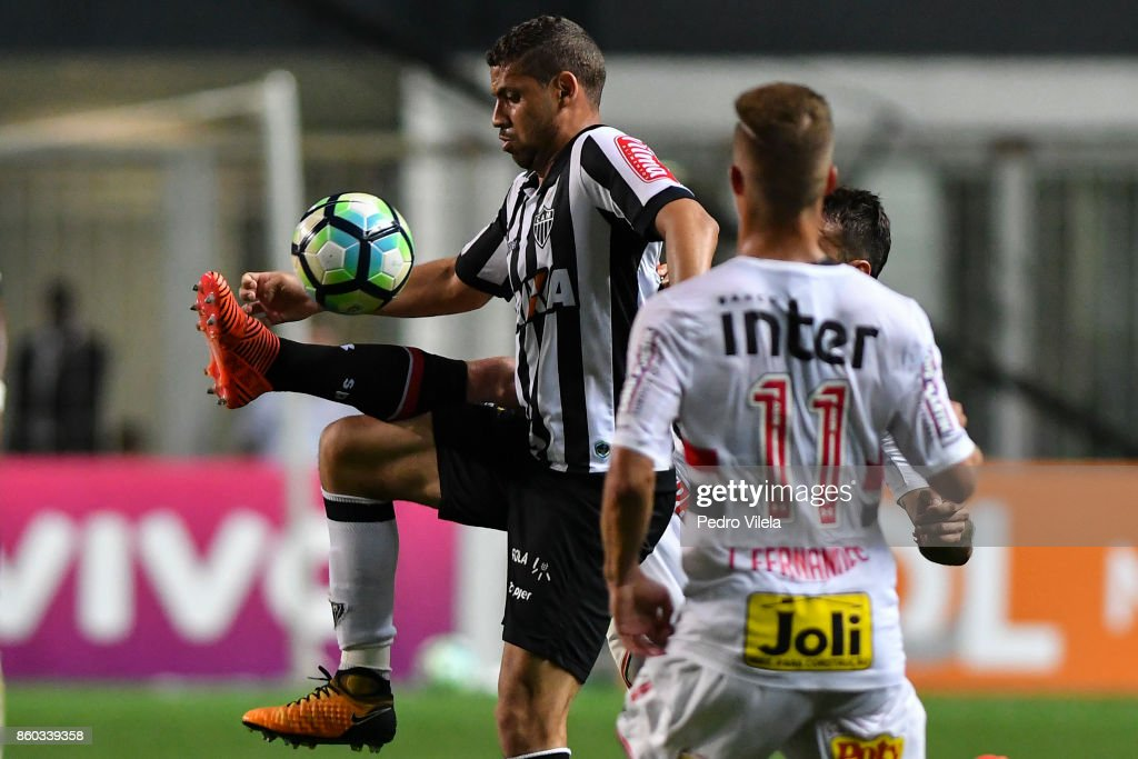 Gabriel #30 of Atletico MG and Lucas Pratto #9 and Lucas Fernandes #29 of Sao Paulo battle for the ball during a match between Atletico MG and Sao Paulo as part of Brasileirao Series A 2017 at Independencia stadium on October 11, 2017 in Belo Horizonte, Brazil.