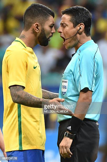 Gabriel of Brazil argues with referee Alireza Faghani during the Rio 2016 Olympic Games mens first round Group A football match Brazil vs Denmark at...