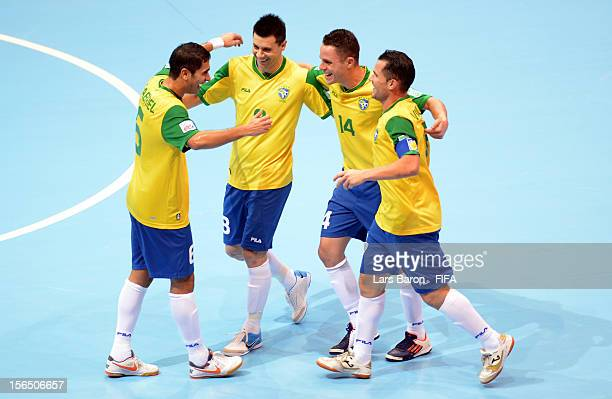 Gabriel of Brazil celebrates with team mates after scoring a goal during the FIFA Futsal World Cup SemiFinal match between Brazil and Colombia at...