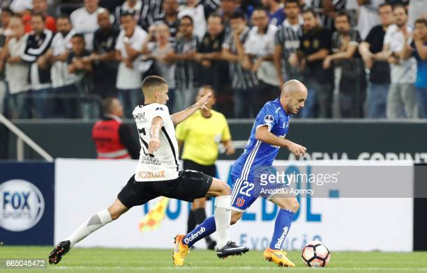 Gabriel of Brazil's Corinthians vies for the ball with G Lorenzetti of Chile's Universidad during the Copa Sudamericana match between Corinthians and...