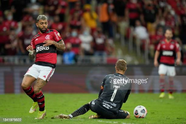 Gabriel of Flamengo fights for the ball with Javier Burrai of Barcelona SC during a semi final first leg match between Flamengo and Barcelona SC as...