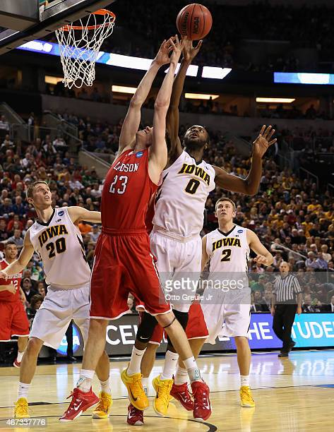 Gabriel Olaseni of the Iowa Hawkeyes battles Peyton Aldridge of the Davidson Wildcats during the second round of the 2015 Men's NCAA Basketball...