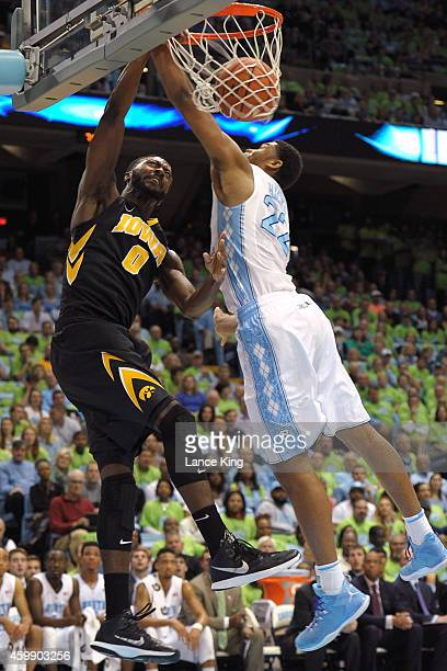 Gabriel Olaseni of the Iowa Hawkeyes dunks against Isaiah Hicks of the North Carolina Tar Heels during their game at the Dean Smith Center on...