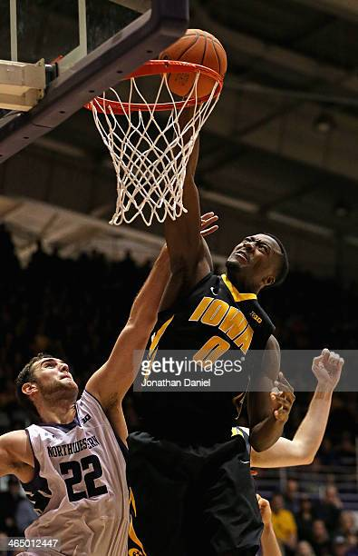 Gabriel Olaseni of the Iowa Hawkeyes dunks over Alex Olah of the Northwestern Wildcats at WelshRyan Arena on January 25 2014 in Evanston Illinois