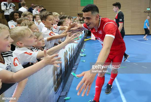 Gabriel Oliviera of Hohenstein Ernstthal celebrates with his supporters after winning the German Futsal Championship final match between VfL...
