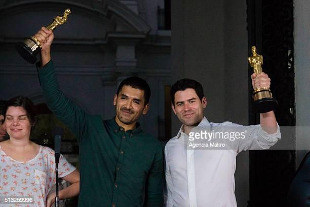 Gabriel Osorio director of the short film Bear Story and producer Patricio Escala pose for photos raising their Oscars during a meeting at Palacio de...