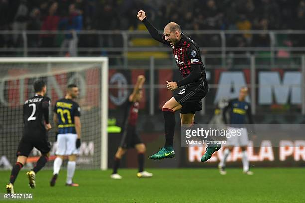 Gabriel Paletta of AC Milan celebrates after his team mate Fernandez Suso scored the opening goal during the Serie A match between AC Milan and FC...