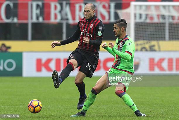 Gabriel Paletta of AC Milan competes for the ball with Diego Falcinelli of FC Crotone during the Serie A match between AC Milan and FC Crotone at...