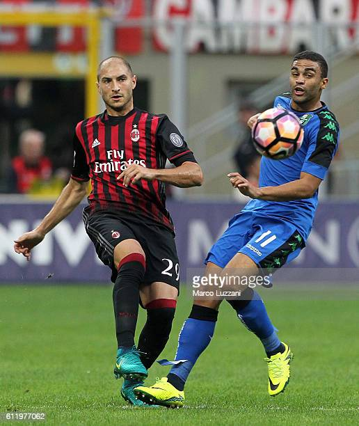 Gabriel Paletta of AC Milan is challenged by Gregoire Defrel of US Sassuolo during the Serie A match between AC Milan and US Sassuolo at Stadio...