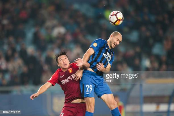 Gabriel Paletta of Jiangsu Suning and Ren Hang of Hebei China Fortune head the ball during the 2018 Chinese Super League 28th round match between...