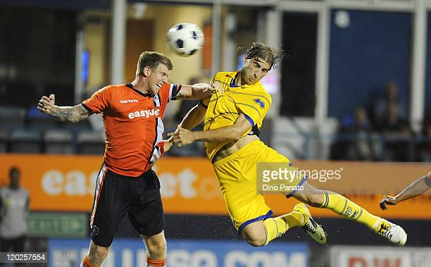 Gabriel Paletta of Parma battles for the ball in the air with Dean Beckwith of Luton Town during a pre season friendly match between Luton Town and...