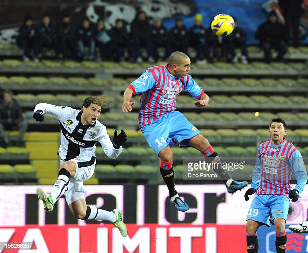 Gabriel Paletta of Parma FC competes with Giuseppe Bellusci of Catania Calcio during the TIM Cup match between Parma FC and Catania Calcio at Stadio...