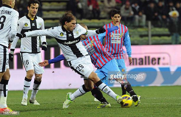 Gabriel Paletta of Parma FC competes with Takayuki Morimoto of Catania Calcio during the TIM Cup match between Parma FC and Catania Calcio at Stadio...