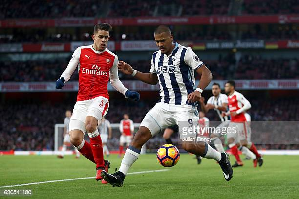 Gabriel Paulista of Arsenal battles for the ball with Jose Salomon Rondon of West Bromwich Albion during the Premier League match between Arsenal and...