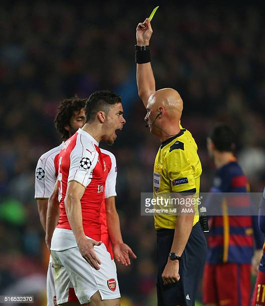 Gabriel Paulista of Arsenal shouts at referee Sergey Karasev as he shows a yellow card during the UEFA Champions League match between FC Barcelona...