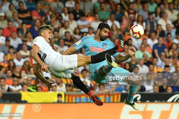Gabriel Paulista of Valencia and Diego Costa of Atletico Madrid in action during the La Liga match between Valencia CF and Club Atletico de Madrid at...