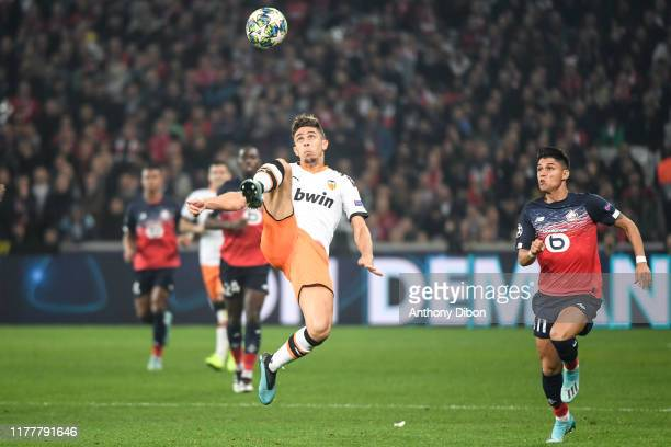 Gabriel PAULISTA of Valencia and Luiz ARAUJO of Lille during the UEFA Champions League Group H match between Lille and Valencia on October 23 2019 in...