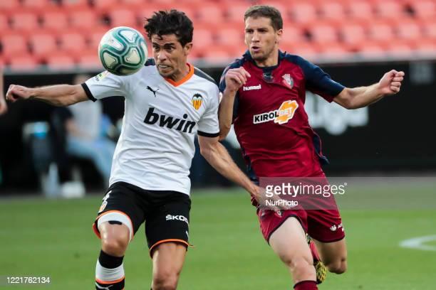 Gabriel Paulista of Valencia CF and Darko Brasanac of CA Osasuna during La Liga match between Valencia CF and CA Osasuna at Mestalla Stadium on June...