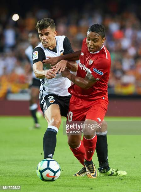 Gabriel Paulista of Valencia CF and Luis Fernando Muriel of Sevilla FC in action during the La Liga match between Valencia CF and Sevilla FC at...