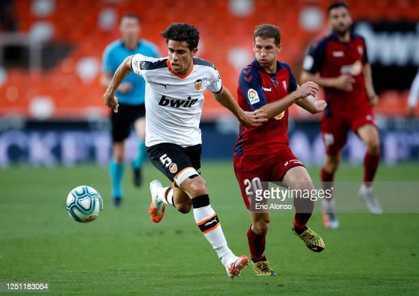 Gabriel Paulista of Valencia CF battles for possession with Darko Brasanac of CA Osasuna during the La Liga match between Valencia CF and CA Osasuna...