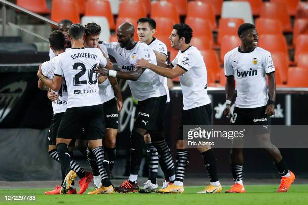 Gabriel Paulista of Valencia CF celebrates with his team mates after scoring his team's first goal during the La Liga match between Valencia CF and...
