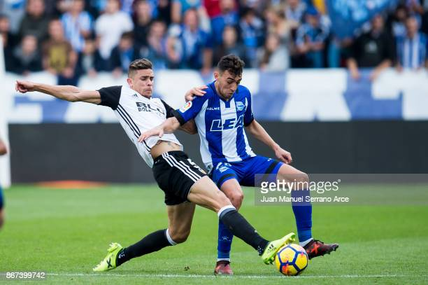 Gabriel Paulista of Valencia CF duels for the ball with Munir El Haddadi of Deportivo Alaves during the La Liga match between Deportivo Alaves and...