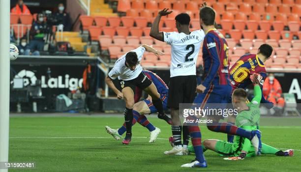 Gabriel Paulista of Valencia CF scores their side's first goal during the La Liga Santander match between Valencia CF and FC Barcelona at Estadio...