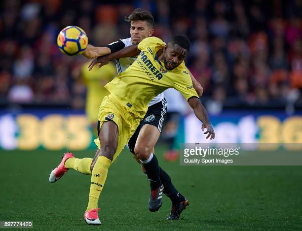 Gabriel Paulista of Valencia competes for the ball with Cedric Bakambu of Villarreal during the La Liga match between Valencia and Villarreal at...