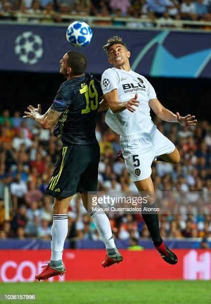 Gabriel Paulista of Valencia competes for the ball with Leonardo Bonucci of Juventus during the Group H match of the UEFA Champions League between...