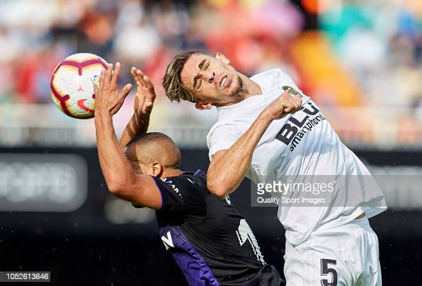 Gabriel Paulista of Valencia competes for the ball with Nabil El Zhar of Leganes during the La Liga match between Valencia CF and CD Leganes at...