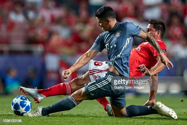 Gabriel Pires of Benfica competes for the ball with James Rodriguez of Bayern Munich during the Group E match of the UEFA Champions League between SL...