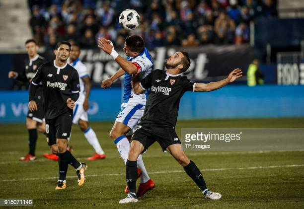 Gabriel Pires of Leganes and a player of Sevilla battle for the ball during the Copa del Rey semifinal first leg match between CD Leganes and Sevilla...