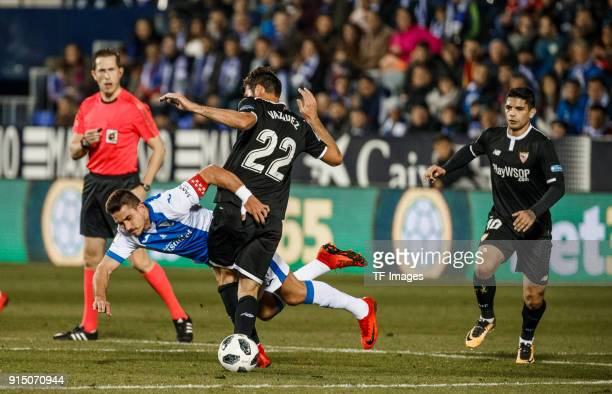 Gabriel Pires of Leganes and Franco Vazquez of Sevilla battle for the ball during the Copa del Rey semifinal first leg match between CD Leganes and...