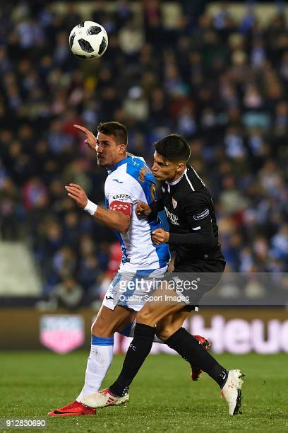 Gabriel Pires of Leganes competes for the ball with Joaquin Correa of Sevilla during the Copa del Rey semifinal first leg match between CD Leganes...