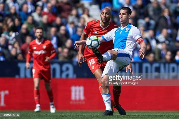 Gabriel Pires of Leganes competes for the ball with Steven N'Zonzi of Sevilla during the La Liga match between Leganes and Sevilla at Estadio...