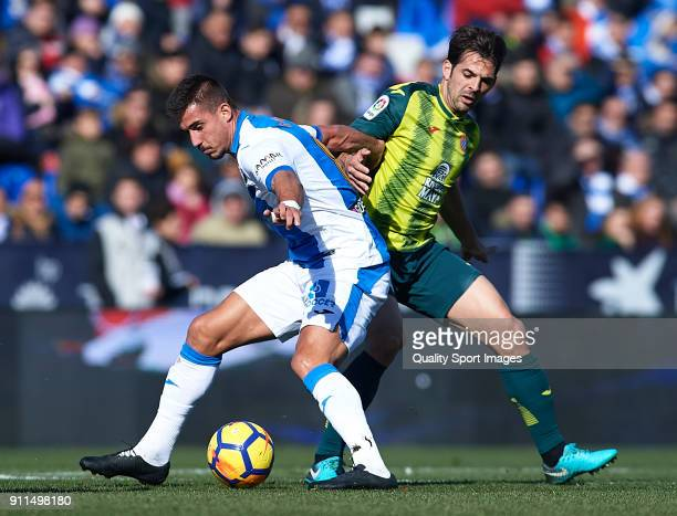 Gabriel Pires of Leganes competes for the ball with Victor Sanchez of Espanyol during the La Liga match between Leganes and Espanyol at Estadio...