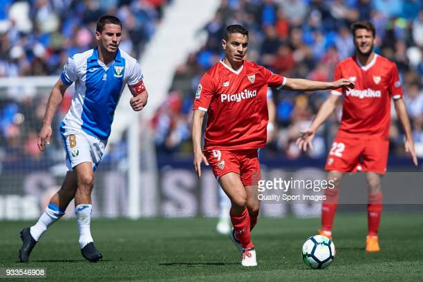 Gabriel Pires of Leganes competes for the ball with Wissam Ben Yedder of Sevilla during the La Liga match between Leganes and Sevilla at Estadio...