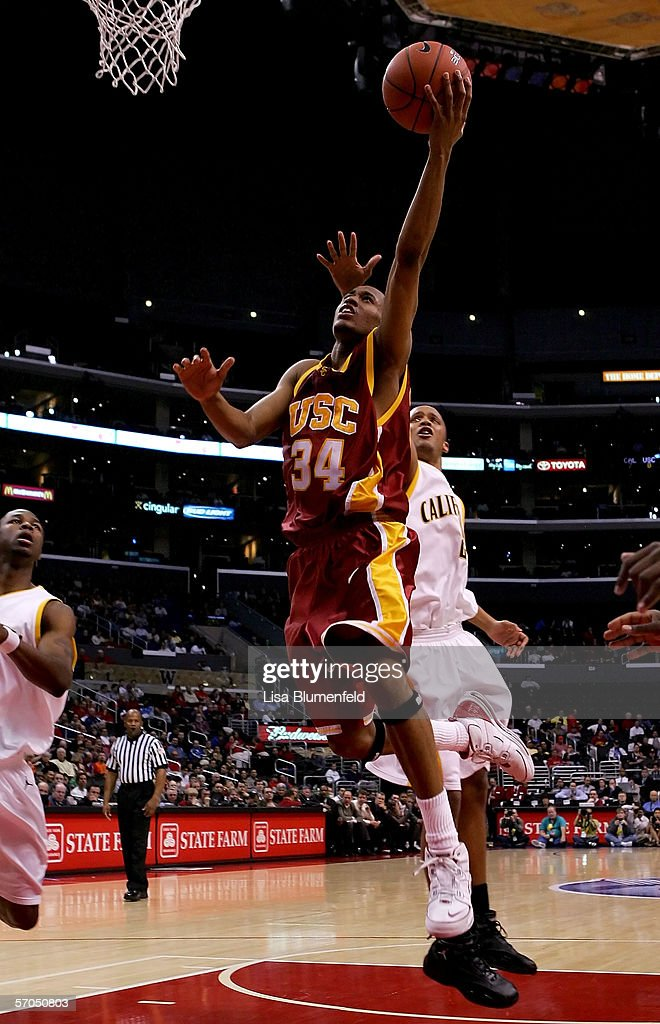 Gabriel Pruitt #34 of the USC Trojans goes to the basket past Omar Wilkes #2 of the California Golden Bears during the quarterfinals of the 2006 Pacific Life Pac-10 Men's Basketball Tournament on March 9, 2006 at Staples Center in Los Angeles, California.