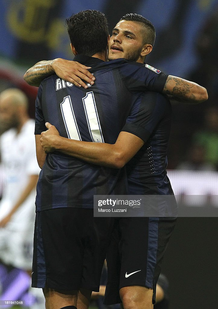 Gabriel Ricardo Alvarez (L) and Mauro Emanuel Icardi (R) of FC Internazionale Milano celebrate a victory at the end of the Serie A match between FC Internazionale Milano and ACF Fiorentina at Giuseppe Meazza Stadium on September 26, 2013 in Milan, Italy.