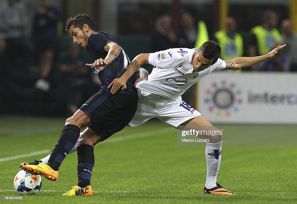Gabriel Ricardo Alvarez of FC Internazionale Milano competes for the ball with Matias Vecino of ACF Fiorentina during the Serie A match between FC Internazionale Milano and ACF Fiorentina at Giuseppe Meazza Stadium on September 26, 2013 in Milan, Italy.