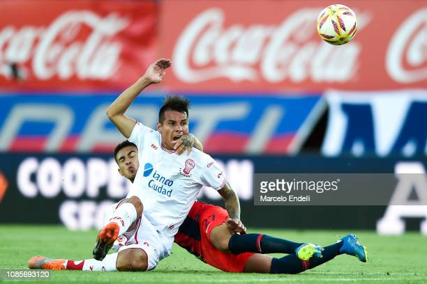 Gabriel Rojas of San Lorenzo fights for the ball with Carlos Auzqui of Huracán during a match between San Lorenzo and Huracan as part of Round 13 of...