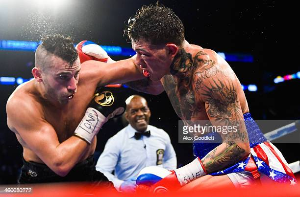 Gabriel Rosado throws a punch at David Lemieux during a NABF Middleweight title fight at the Barclays Center on December 6 2014 in the Brooklyn...