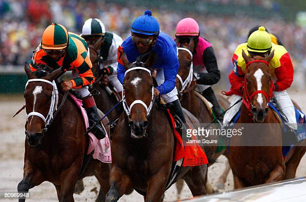 Gabriel Saez riding Proud Spell and Rajiv Maragh riding Little Belle lead a pack of horses on the front stretch during the 134th running of the...