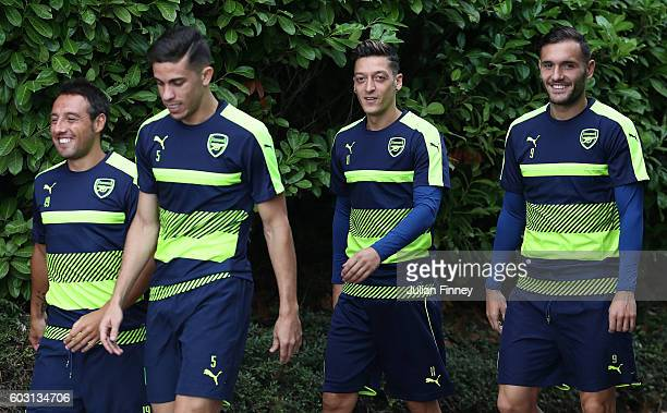 Gabriel Santi Cazorla Lucas Perez and Mezut Ozil of Arsenal arrive during Arsenal training session ahead of their Champions League match against PSG...